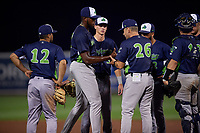 Vermont Lake Monsters Aaron Nieckula (26) hands the game ball to pitcher Jeferson Mejia (37) as Jordan Diaz (12), Logan Davidson (3), and Yerdel Vargas (2) look on during a NY-Penn League game against the Aberdeen IronBirds on August 19, 2019 at Leidos Field at Ripken Stadium in Aberdeen, Maryland.  Aberdeen defeated Vermont 6-2.  (Mike Janes/Four Seam Images)