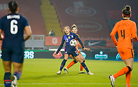 BREDA, NETHERLANDS - NOVEMBER 27: Alex Morgan #13 of the United States attempts to move past Netherlands during a game between Netherlands and USWNT at Rat Verlegh Stadion on November 27, 2020 in Breda, Netherlands.