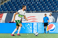 FOXBOROUGH, MA - AUGUST 26: Evan Lee #12 of Greenville Triumph SC looks to pass during a game between Greenville Triumph SC and New England Revolution II at Gillette Stadium on August 26, 2020 in Foxborough, Massachusetts.