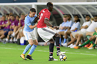Houston, TX - Thursday July 20, 2017: Phil Foden and Paul Pogba during a match between Manchester United and Manchester City in the 2017 International Champions Cup at NRG Stadium.