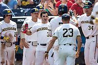 Michigan Wolverines pitcher Joe Pace (32) celebrates after Michigan scores during Game 1 of the NCAA College World Series against the Texas Tech Red Raiders on June 15, 2019 at TD Ameritrade Park in Omaha, Nebraska. Michigan defeated Texas Tech 5-3. (Andrew Woolley/Four Seam Images)