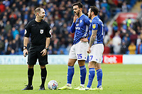 (L-R) Referee Jeremy Simpson speaks to Marlon Pack and Lee Tomlin of Cardiff City before a free kick is taken during the Sky Bet Championship match between Cardiff City and Preston North End at the Cardiff City Stadium, Wales, UK. Saturday 21 December 2019