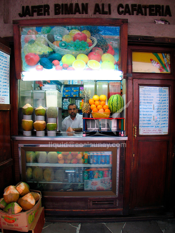 Dubai (in Arabic: ????, transliteration: Dubai¯y) is one of the seven emirates and the most populous city of the United Arab Emirates (UAE). It is located along the southern coast of the Persian Gulf on the Arabian Peninsula. The municipality of Dubai is sometimes called Dubai city to distinguish it from the emirate..Written accounts document the existence of the city for at least 150 years prior to the formation of the UAE. Dubai shares legal, political, military and economic functions with the other emirates within a federal framework, although each emirate has jurisdiction over some functions such as civic law enforcement and provision and upkeep of local facilities. Dubai has the largest population and is the second largest emirate by area, after Abu Dhabi. Dubai and Abu Dhabi are the only two emirates to possess veto power over critical matters of national importance in the country's legislature.Dubai has been ruled by the Al Maktoum dynasty since 1833. Dubai's current ruler, Mohammed bin Rashid Al Maktoum, is also the Prime Minister and Vice President of the UAE..The emirate's revenues are from trade, real estate and financial services. Revenues from petroleum and natural gas contribute less than 6% (2006) of Dubai's US$ 37 billion economy (2005). Real estate and construction, on the other hand, contributed 22.6% to the economy in 2005, before the current large-scale construction boom.Dubai has attracted worldwide attention through innovative real estate projects  and sports events. This increased attention, coinciding with its emergence as a world business hub, has also highlighted human rights issues concerning its largely foreign workforce.