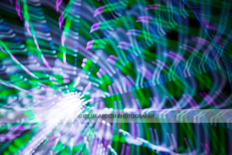 """A combination of photography techniques called """"focus blur"""" and """"zoom blur"""" are used to transform the lights of the ferris wheel into abstract designs at the Montgomery County Agricultural Fair in Gaithersburg, Maryland."""