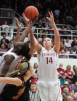 STANFORD, CA - January 22, 2011:  Chiney Ogwumike (13) and Kayla Pedersen (14) pull down an offensive rebound during Stanford's 95-51 victory over USC at Stanford, California on January 22, 2011.
