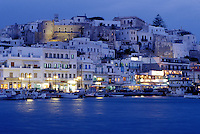 Greece, Naxos, Greek Islands, Cyclades, Europe, Waterfront on Hora Naxos Harbor in the evening on Naxos Island on the Aegean Sea.