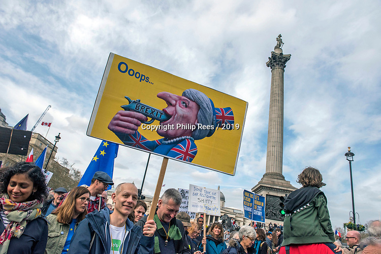 """Protesters with Theresa May placard in front of Nelson's Column during the """"Put it to the People"""" rally whch made it's way through central London today. Demonstrators from across the country gathered to call for a second referendum on Brexit and to march through the UK capital finishing with speeches in Parliament Square opposite the Houses of Parliament in Westminster."""