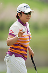 CHON BURI, THAILAND - FEBRUARY 16:  Jiyai Shin of South Korea waves to the crowd after a putt on the 8th hole during day one of the LPGA Thailand at Siam Country Club on February 16, 2012 in Chon Buri, Thailand.  Photo by Victor Fraile / The Power of Sport Images