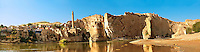 Remains of medieval Artukid Old Tigris Bridge – Built in 1116 by Artukid Fahrettin Karaaslan, the biggest in Anatolia at the time, with the old town Hasankeyf and its ruins on the cliffs abover the river Tigris. The minaret is of the El Rizk Mosque built 1409.  Turkey. 4