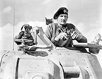 General Bernard L. Montgomery watches his tanks move up.  North Africa, November 1942.  British Official.  (OWI)<br /> Exact Date Shot Unknown