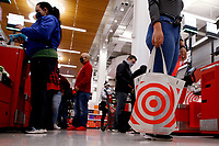 NEW YORK - NEW YORK - APRIL 13: A woman carries a reusable bag at Target Store on April 13, 2021 in New York. More than 300 corporates including Google and Mc Donalds are pushing the Biden administration to almost double the United States target for cutting the planet warming emissions, ahead global summit on climate change in 2021. (Photo by John Smith/VIEWpress)