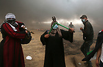 Palestinian women take part during clashes with Israeli security forces in tents protest where Palestinians demanding the right to return to their homeland, at the Israel-Gaza border, in Khan Younis in the southern Gaza Strip, on May 4, 2018. Photo by Yasser Qudih