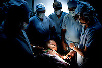 Victoria is surrounded by surgeons as she is taken to the operating theatre to have fluid drained from her head at Annapurna Neurological Institute in Kathmandu. 19 month old Victoria (formerly named Ghane) was born with hydrocephalus and was left abandoned. Cecilie Hansen was so moved by the story of Ghane she read in a Danish newspaper that she decided to fly to Kathmandu to try to assist her and show her the love of another human being; Cecilie eventually became her legal guardian. Victoria died on November 19 2010 from heart failure.