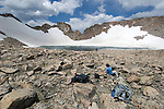 people, (MR), Rowe Glacier, lake, rock scree, high elevation, alpine, landscape, cumulus, clouds, rocky, snow, summer, August, afternoon, Rocky Mountain National Park, Colorado, USA