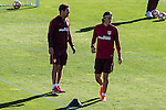 Atletico de Madrid's coach Diego Pablo Cholo Simeone and Filipe Luis during the training of preseason at Cerro del Espino in Madrid. August 11, 2016. (ALTERPHOTOS/Rodrigo Jimenez)
