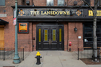 The Lansdowne Pub, located across Lansdowne Street from Fenway Park, is temporarily closed during the ongoing Coronavirus (COVID-19) global pandemic in Boston, Massachusetts, seen here on Wed., Jan. 6, 2021. The plants appear to have been moved to the window to maximize their exposure to sunlight during the closure. A facebook post from the bar on Nov. 28, 2020, states that the Lansdowne hopes to reopen in March 2021.