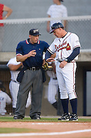 Danville Braves manager Paul Runge (12) explains to home plate umpire Jeff Klinghoffer that he feels the pitcher for the Elizabethton Twins is not keeping his foot on the rubber at Dan Daniels Park in Danville, VA, Saturday, August 23, 2008. (Photo by Brian Westerholt / Four Seam Images)