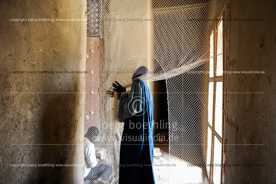 MALI, Djenne , Grand Mosque built from clay is an UNESCO world heritage, inside the mosque, entrance with curtain