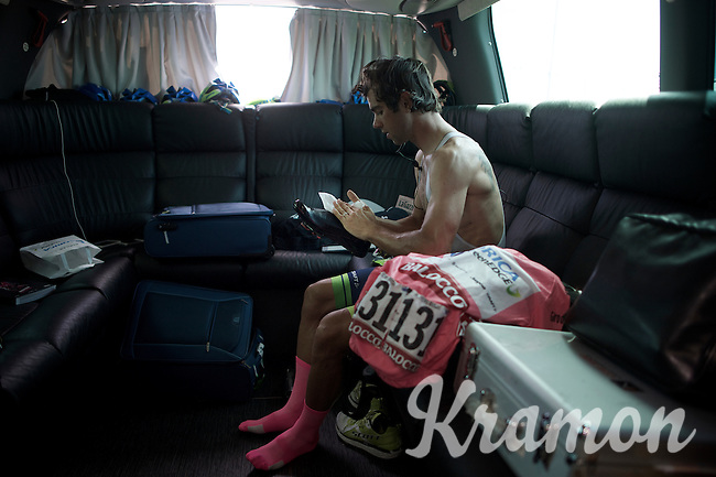 Michael Matthews (AUS/Orica-GreenEDGE) gets ready for the race & shines his shoes in the back of the teambus as his maglia rosa lays beside him.<br /> <br /> 2015 Giro<br /> st4: Chiavari - La Spezia (150km)