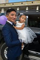 Mongolia, Ulaanbaatar. Wedding photos in Sukhbaatar Square.
