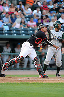 Great Lakes Loons catcher Jose Capellan (6) throws down to second in front of Reynaldo Bruguera (9) during a game against the Fort Wayne TinCaps on August 19, 2013 at Dow Diamond in Midland, Michigan.  Great Lakes defeated Fort Wayne 12-5.  (Mike Janes/Four Seam Images)