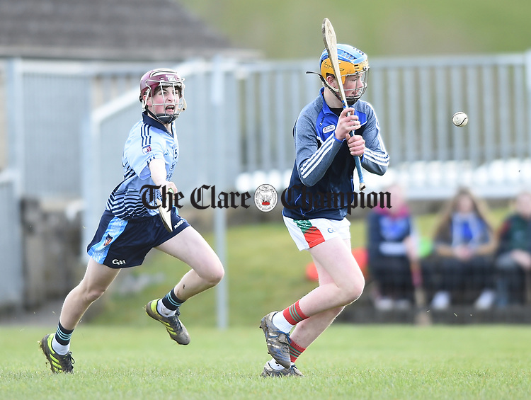 Fergus Madden of Scariff Community College in action against Cathal Dunne of St Fergal's College during their All-Ireland Colleges final at Toomevara. Photograph by John Kelly.