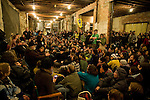 Hundreds of environmental activists gather at the headquarters of the Capitol Coal Action the night before the planned march on the coal plant. On March 2, 2009, thousands of protestors marched on the Capitol Coal Plant in Washington, D.C. The protestors were calling for clean renewable energy future. Two days before the planned protest, the US government announced that the plant would be converted to Natural Gas. Organizers cited this news as a partial, but incomplete victory - as Natural Gas is still a fossil fuel - and vowed to take on coal plants across the country.  (©Robert vanWaarden).