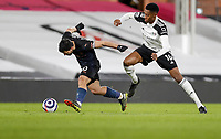 13th March 2021, Craven Cottage, London, England;  Manchester Citys Sergio Aguero  with Fulhams Tosin Adarabioyo challenging during the English Premier League match between Fulham and Manchester City at Craven Cottage in London
