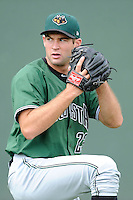 Starting pitcher Christian Jones (23) of the Augusta GreenJackets warms up before a game against the Greenville Drive on Sunday, July 13, 2014, at Fluor Field at the West End in Greenville, South Carolina. Greenville won, 8-5. (Tom Priddy/Four Seam Images)