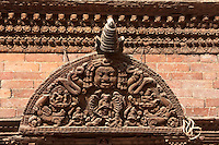 Kathmandu, Nepal.  Wood Carving above a Door in the Kumari Bahal, House of the Kumari Devi, a Young Girl Revered as a Living Goddess.  The wood used is sal wood, shorea robusta.  The house was constructed in 1757.