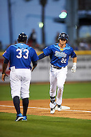 Corpus Christi Hooks center fielder Derek Fisher (22) congratulated by manager Rodney Linares (33) as he rounds third after hitting a home run during a game against the Frisco RoughRiders on April 23, 2016 at Whataburger Field in Corpus Christi, Texas.  Corpus Christi defeated Frisco 3-2.  (Mike Janes/Four Seam Images)