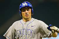Luke Maile #21 of the Kentucky Wildcats fist bumps a teammate after scoring a run against the Rice Owls at Minute Maid Park on March 4, 2011 in Houston, Texas.  Photo by Brian Westerholt / Four Seam Images