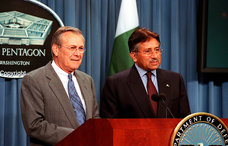Feb. 13, 2002, Washington, DC, United States<br /> <br /> Pakistani President Pervez Musharraf (right) responds to a reporter's question during a joint press conference with Secretary of Defense Donald H. Rumsfeld (left) in the Pentagon on Feb. 13, 2002.  Musharraf and Rumsfeld met earlier to discuss the war on terrorism and defense issues of mutual interest.<br /> <br /> Mandatory Credit: Photo by DoD photo byHelene C. Stikke (Released)- Images Distribution. <br /> Public domain photo send by and payable to Images Distribution