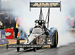 Champion Tony Schumacher #1, driver for the Army's Top Fuel Dragster does a burn out at the O'Reilly Fall Nationals held at the Texas Motorplex in  Ennis, Texas.