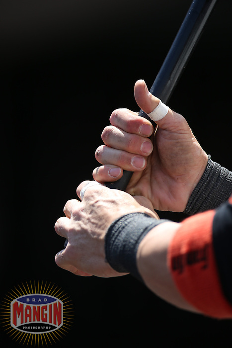 SAN FRANCISCO, CA - MAY 8:  Detail of Marco Scutaro #19 of the San Francisco Giants gripping a bat in the dugout during the game against the Philadelphia Phillies at AT&T Park on Wednesday, May 8, 2013 in San Francisco, California. Photo by Brad Mangin
