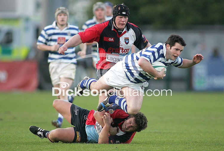 Dungannon replacement Andrew Kirkpatrick is tackled by Harlequins hooker Stuart Philpott during the First Trust Senior Cup Final at Ravenhill. Result - Dungannon 27pts Harlequins 10pts.