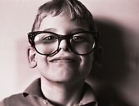 Young Boy wearing large glasses