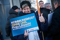 Kundgebung der CDU-Lichtenberg gegen Kommunismus.<br /> Etwa ein dutzend Mitglieder der CDU aus dem Berliner Stadtteil Lichtenberg protestierten am Samstag den 22. Januar 2011 gegen den Kommunismus. Anlass war ein umstrittener Artikel zum Thema Kommunismus der Vorsitzenden der Linkspartei Die LINKE, Gesine Loetzsch.<br /> Ungefaehr 30 Gegendemonstranten stoerten die CDU-Kundgebung mit Plakaten und Schildern.<br /> 22.1.2011, Berlin<br /> Copyright: Christian-Ditsch.de<br /> [Inhaltsveraendernde Manipulation des Fotos nur nach ausdruecklicher Genehmigung des Fotografen. Vereinbarungen ueber Abtretung von Persoenlichkeitsrechten/Model Release der abgebildeten Person/Personen liegen nicht vor. NO MODEL RELEASE! Don't publish without copyright Christian-Ditsch.de, Veroeffentlichung nur mit Fotografennennung, sowie gegen Honorar, MwSt. und Beleg. Konto:, I N G - D i B a, IBAN DE58500105175400192269, BIC INGDDEFFXXX, Kontakt: post@christian-ditsch.de]