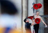 Artisti circensi si esibiscono durante l'incontro del Papa con le famiglie in Piazza San Pietro, Citta' del Vaticano, 26 ottobre 2013.<br /> Circus artists perform during a meeting attended by the Pope with families in St. Peter's Square at the Vatican, 26 October 2013.<br /> UPDATE IMAGES PRESS/Riccardo De Luca<br /> <br /> STRICTLY ONLY FOR EDITORIAL USE