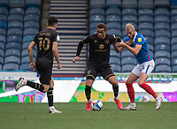 Portsmouth's Jack Whatmough (right) vies for possession with Milton Keynes Dons' Carlton Morris (centre)<br /> <br /> Photographer David Horton/CameraSport<br /> <br /> The EFL Sky Bet League One - Portsmouth v Milton Keynes Dons - Saturday 10th October 2020 - Fratton Park - Portsmouth<br /> <br /> World Copyright © 2020 CameraSport. All rights reserved. 43 Linden Ave. Countesthorpe. Leicester. England. LE8 5PG - Tel: +44 (0) 116 277 4147 - admin@camerasport.com - www.camerasport.com