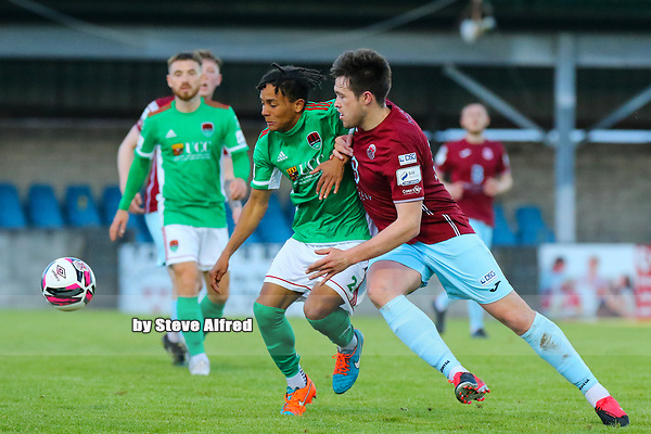 Uniss Kargbo of Cork City with Jake Hegarty of Cobh Ramblers.<br /> <br /> Cobh Ramblers v Cork City, SSE Airtricity League Division 1, 28/5/21, St. Colman's Park, Cobh.<br /> <br /> Copyright Steve Alfred 2021.