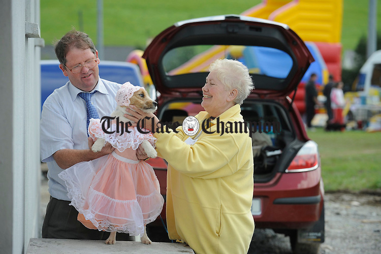 """Padraig and Mary Burke of Ballinasloe prepare their year and a half year old Jack Russell """"Holly"""" for the fancy dress section at Scariff Show. Photograph by John Kelly."""