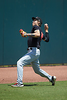 Hickory Crawdads pitcher Hans Crouse (10) throws in the outfield following the game against the Charleston RiverDogs at L.P. Frans Stadium on May 13, 2019 in Hickory, North Carolina. The Crawdads defeated the RiverDogs 7-5. (Brian Westerholt/Four Seam Images)