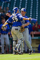 Catcher Michael Williams #35 of the Kentucky Wildcats hugs pitcher Trevor Gott #29 after the final out of their 2-1 win over the Utah Utes at Minute Maid Park on March 6, 2011 in Houston, Texas.  Photo by Brian Westerholt / Four Seam Images