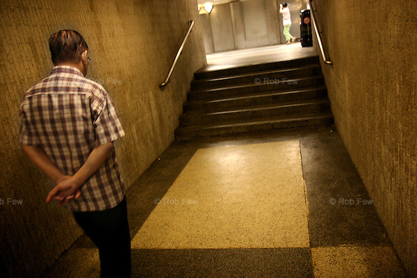 Lonliness. Two old people on the Hong Kong underground not meeting.