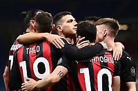 Hakan Calhanoglu of AC Milan (R) celebrates with team mates after scoring the goal of 1-0 during the Serie A football match between AC Milan and Benevento Calcio at San Siro Stadium in Milano  (Italy), May 1st, 2021. Photo Matteo Gribaudi / Image Sport / Insidefoto