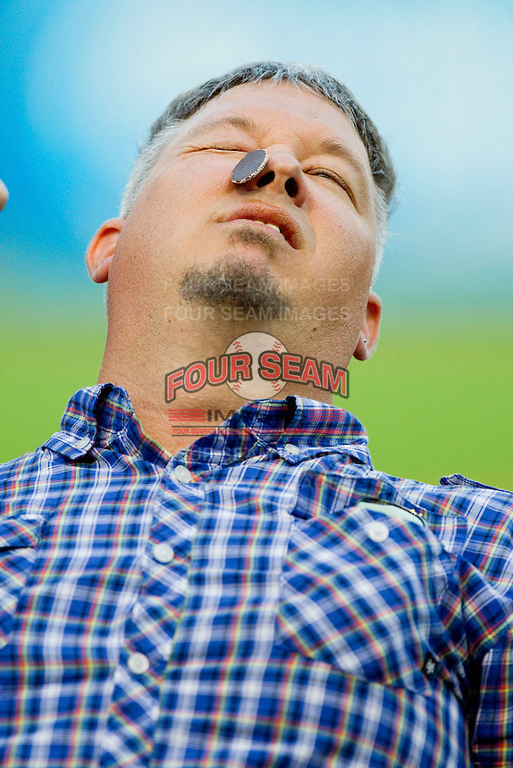 Bryan Short of Winston-Salem, NC competes in a contest where you have to get a piece of candy from your forehead to your mouth using only your facial muscles between innings of the 2012 California-Carolina League All-Star Game at BB&T Ballpark on June 19, 2012 in Winston-Salem, North Carolina.  The Carolina League defeated the California League 9-1.  (Brian Westerholt/Four Seam Images)