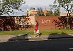 Hartlepool United 0 Sunderland 3, 20/07/2016. Victoria Park, Pre Season Friendly. a woman walking past graffiti and a football mural outside Victoria Park. Photo by Paul Thompson.