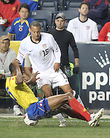 Jermaine Jones #15 of the USA MNT slips the ball under Juan David Valencia #6 of Colombia during an international friendly match at PPL Park, on October 12 2010 in Chester, PA. The game ended in a 0-0 tie.