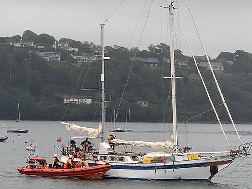 Kinsale RNLI volunteers board the 51ft ketch to assist its solo-sailing skipper